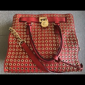 Micheal Kors red leather handbag with gold eyelets